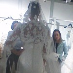 Ian Stuart Lady Luxe finale ivory lace wedding dress with ivory flowers scattered on the jacket and veil