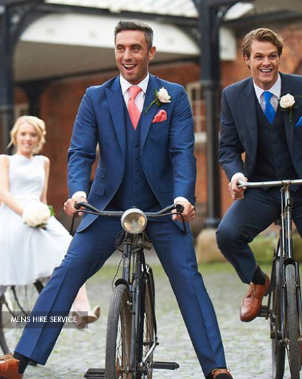 groom and best man on bikes wearing Peter Posh wedding suits for hire at Limelight Occasions near Huddersfield Wakefield and Leeds