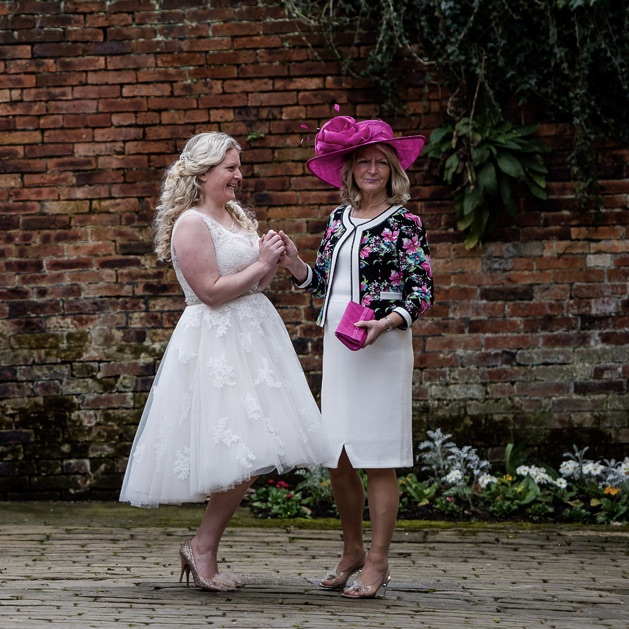 Tea length wedding dress by Ellis bridals, Mother of the bride outfit by Tia, hat by Max and Ellie
