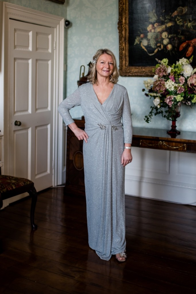 elegant long sleeved full length mother of the bride dress in dove grey with subtle sparkle by John charles