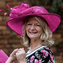 mother of bride bride hats by Max and ellie at Limelight Occasions, fuchsia mother of the bride hat, hat with large flower,