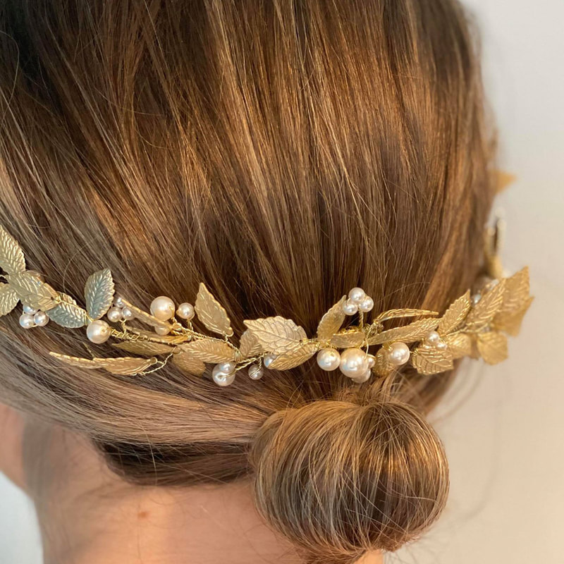 For a boho woodland themed wedding style your wedding dress with the Aurelia half halo hair vine