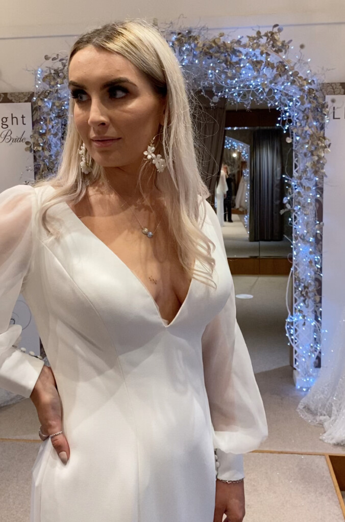 Model and Limelight bride, Kayleigh Barry, wears the Woodstock wedding dress 31143 by Adrianna Papell with Daydream earrings for the perfect boho rustic bridal statement at Limelight Occasions near Huddersfield, wakefield and Leeds