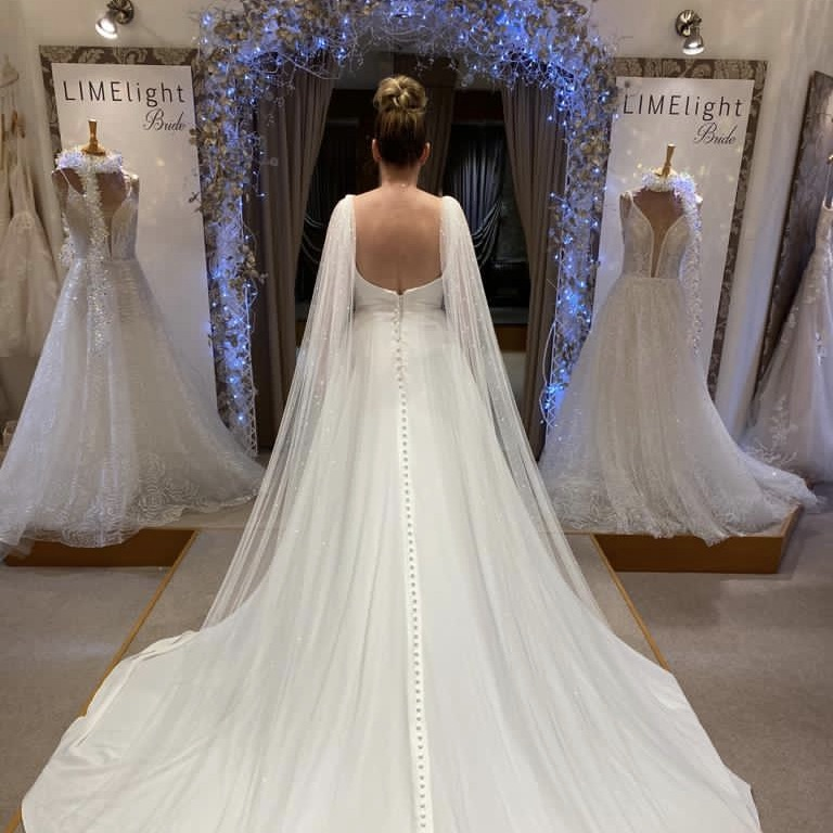 Bridal Angel Wings attached to the shoulders of your wedding dress are a romantic alternative to wearing a wedding veil