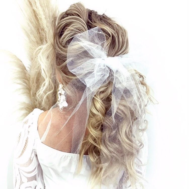 If a veil is not for you style your wedding dress with a tulle hair bow by Tulle and Flo at Limelight Occasions