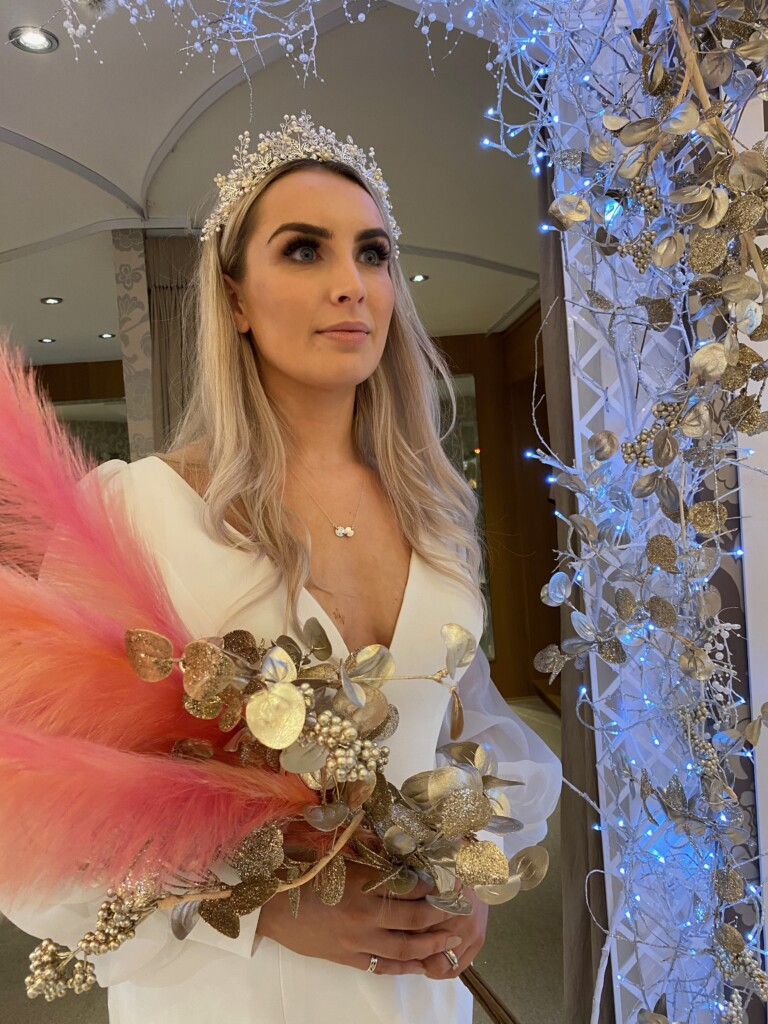 Model and Limelight bride, Kayleigh Barry, wears the Woodstock wedding dress 31143 by Adrianna Papell with the Larkspur Tiara for a romantic bridal statement at Limelight Occasions near Huddersfield, Wakefield and Leeds
