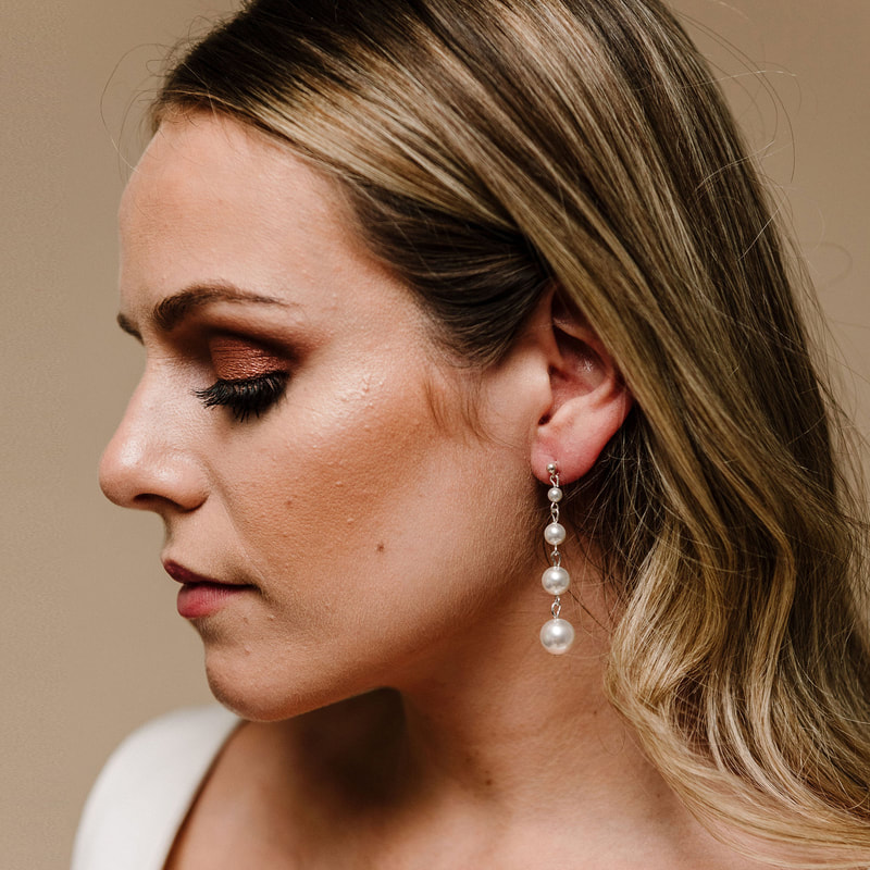 For a pretty, feminine bridal look, style your wedding dress with Purity Drop Earrings ARE 617 by Arianna Tiaras at Limelight Occasions bridal boutique near Huddersfield, Wakefield and Leeds