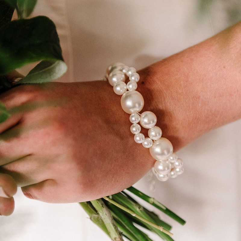 For a simple bridal statement in twists of pearl, style your wedding dress with the Nerina bracelet ARW 612 by Arianna Tiaras at Limelight Occasions bridal boutique near Huddersfield, Wakefield and Leeds