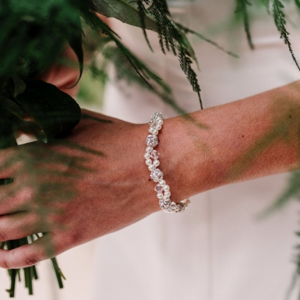 For a pretty bridal statement in delicate twists of pearl and crystal style your wedding dress with Mira bracelet ARW 613 by Arianna Tiaras at Limelight Occasions bridal boutique near Huddersfield, Wakefield and Leeds
